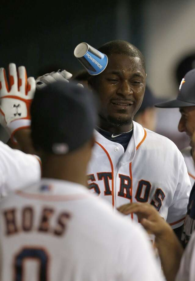 September 3: Astros 4, Angels 1  Chris Carter celebrates his first home run of the game in the dugout in the second inning. Photo: Karen Warren, Houston Chronicle