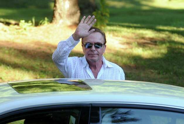 Celebrity David Cassidy waves to the media as he enters Town Court on Wednesday Sept. 3, 2014 in Schodack, N.Y.  (Michael P. Farrell/Times Union) Photo: Michael P. Farrell / 00028445A