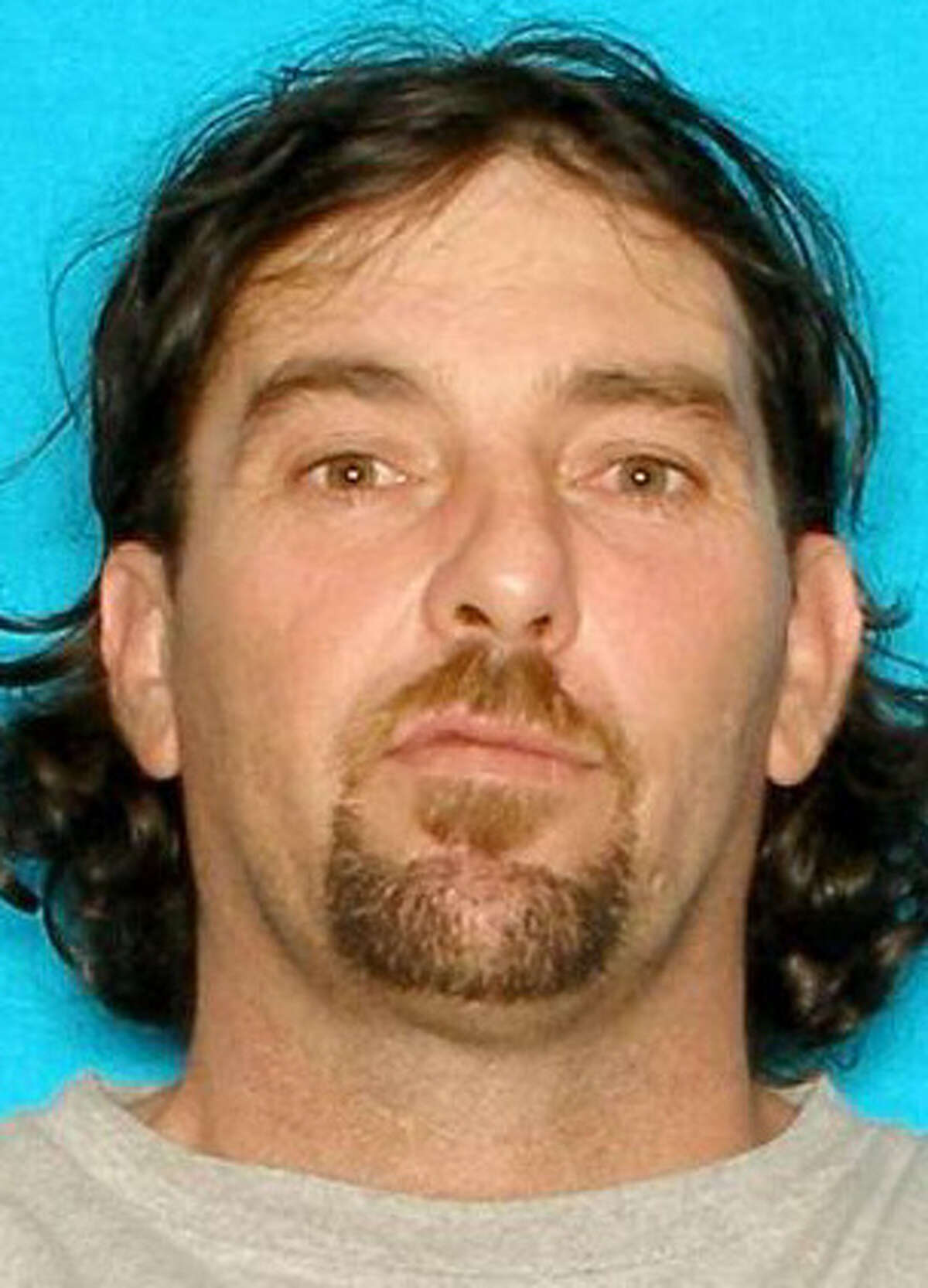 Daniel Goodwin, 41, seen in an undated driver's license photo, was shot in the chest at a 2012 family barbecue.