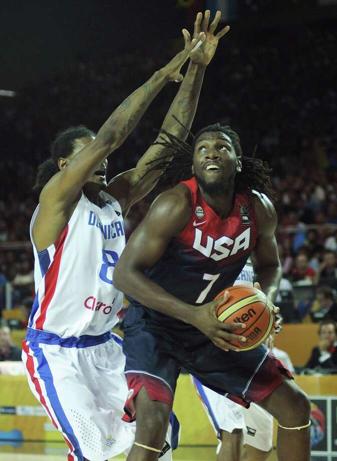 US forward Kenneth Faried (R) vies with Dominican Republic's forward Edward Santana (L) during the 2014 FIBA World basketball championships group C match Dominican Republic vs USA at the Bizkaia Arena in Bilbao on September 3, 2014. AFP PHOTO/ ANDER GILLENEAANDER GILLENEA/AFP/Getty Images ORG XMIT: 509800795 Photo: ANDER GILLENEA / AFP