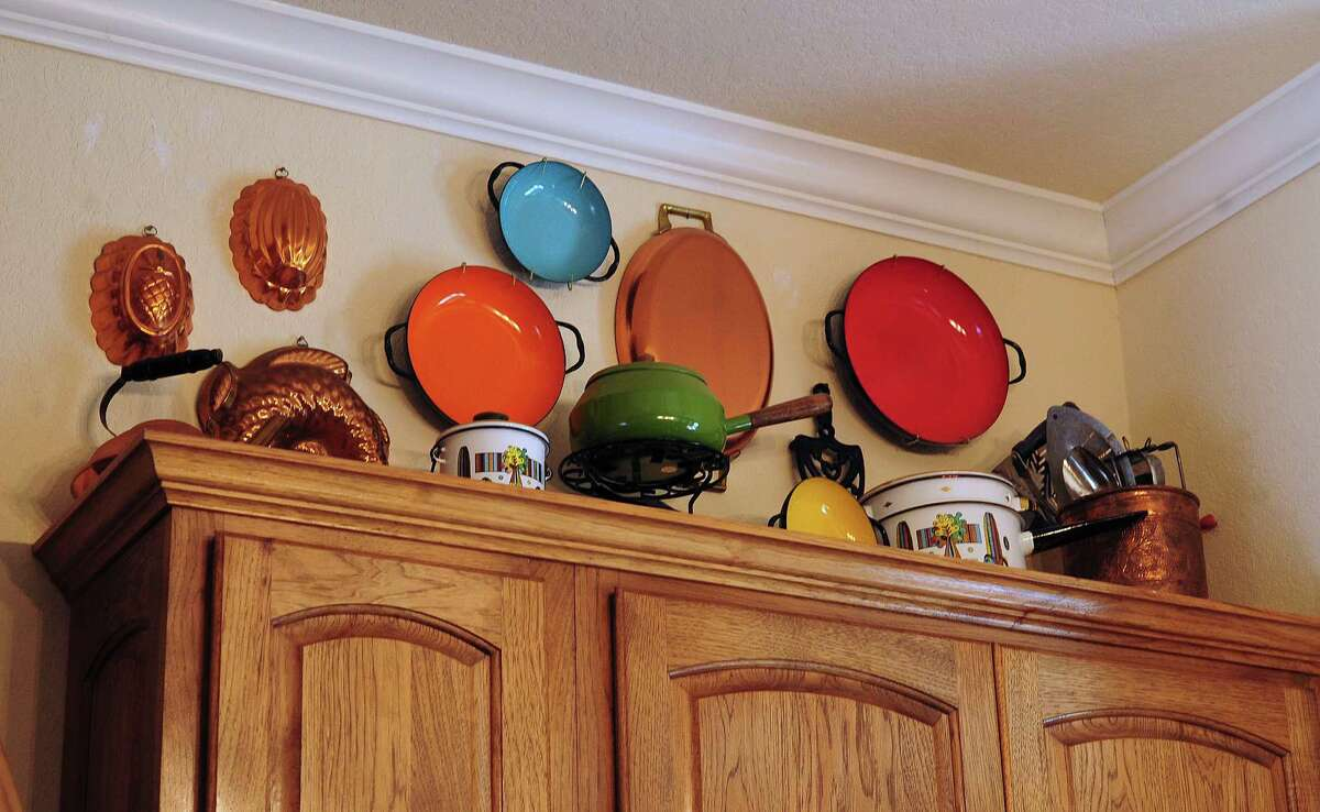 Diana Albrecht sees her childhood in the cookware displayed in her Boerne, Texas, kitchen. Some of the cookware belonged to her mother.