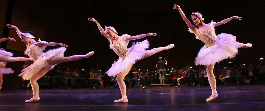 Members of Ballet San Antonio (above) and the San Antonio Symphony (left) rehearse for tonight's inaugural performance at the Tobin Center for the Performing Arts. Photo: Photos By Tom Reel / San Antonio Express-News