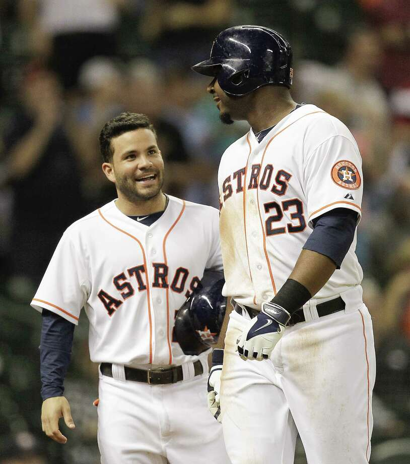 HOUSTON, TX - SEPTEMBER 03:  Chris Carter #23 of the Houston Astros receives congratulations from Jose Altuve #27 after hitting a home in the eighth inning against the Los Angeles Angels of Anaheim at Minute Maid Park on September 3, 2014 in Houston, Texas. Photo: Bob Levey, Getty Images / 2014 Getty Images