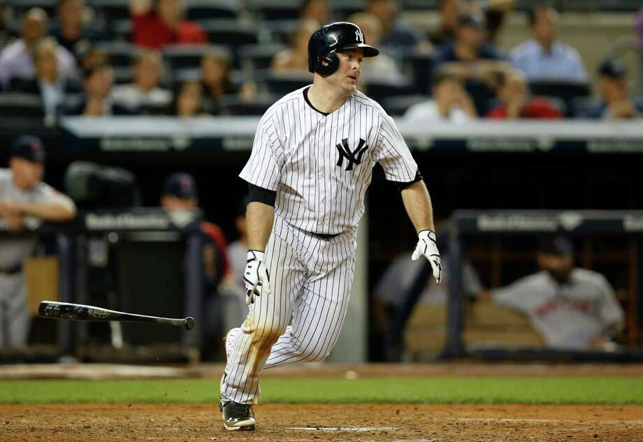 New York Yankees' Brian McCann hits a seventh-inning RBI-single in a baseball game against the Boston Red Sox at Yankee Stadium in New York, Wednesday, Sept. 3, 2014. (AP Photo/Kathy Willens) ORG XMIT: NYY110 Photo: Kathy Willens / AP