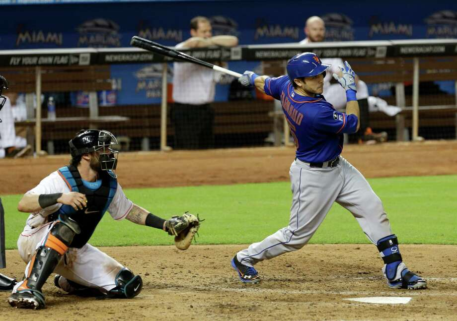 New York Mets' Travis d'Arnaud follows through on a double against the Miami Marlins in the eighth inning of a baseball game in Miami, Wednesday, Sept. 3, 2014. Matt den Dekker scored on the double. The Mets won 4-3. (AP Photo/Alan Diaz)  ORG XMIT: FLAD113 Photo: Alan Diaz / AP