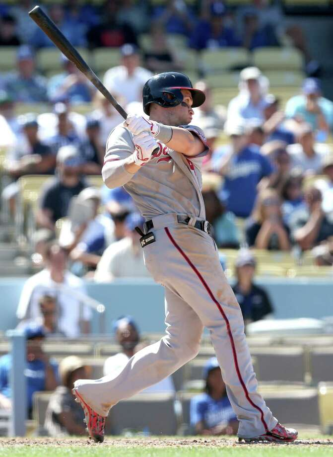 LOS ANGELES, CA - SEPTEMBER 03: Bryce Harper #34 of the Washington Nationals hits a single to start a three run rallyin the ninth inning against the Los Angeles Dodgers at Dodger Stadium on September 3, 2014 in Los Angeles, California.  (Photo by Stephen Dunn/Getty Images) ORG XMIT: 477589345 Photo: Stephen Dunn / 2014 Getty Images