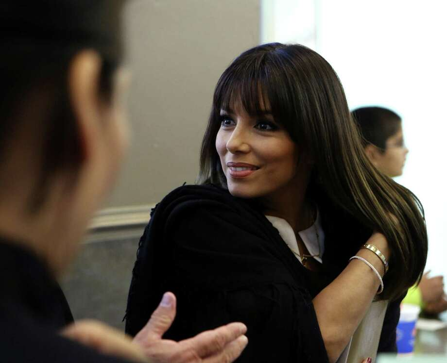 Actress Eva Longoria says local Apple store employees used her personal account information and broke into her email. Photo: San Antonio Express-News / File Photo / ©2013 San Antonio Express-News