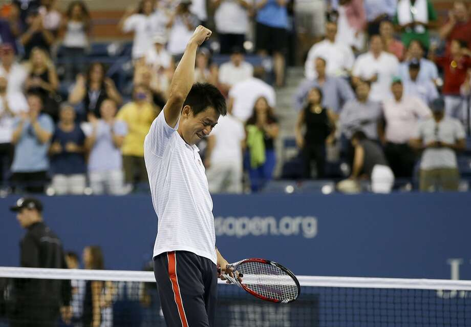 Kei Nishikori celebrates his hard-earned win over Stan Wawrinka, his second five-set match in a day and a half. Photo: Darron Cummings, Associated Press