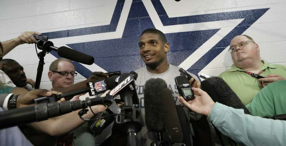 Michael Sam (center), the NFL's first openly gay player, joined the Cowboys' 10-man practice squad Wednesday. Photo: LM Otero / Associated Press / AP