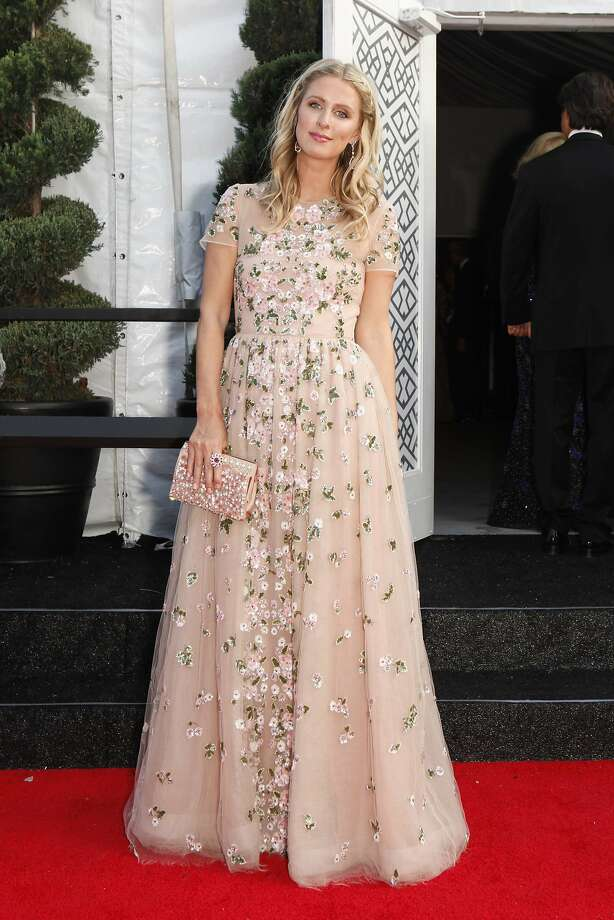 Nicky Hilton poses in a soft pink floral sequined Valentino gown at the San Francisco Symphony Opening Night Gala in San Francisco on Wednesday, Sept. 3, 2014. Photo: Alex Washburn, Special To The Chronicle