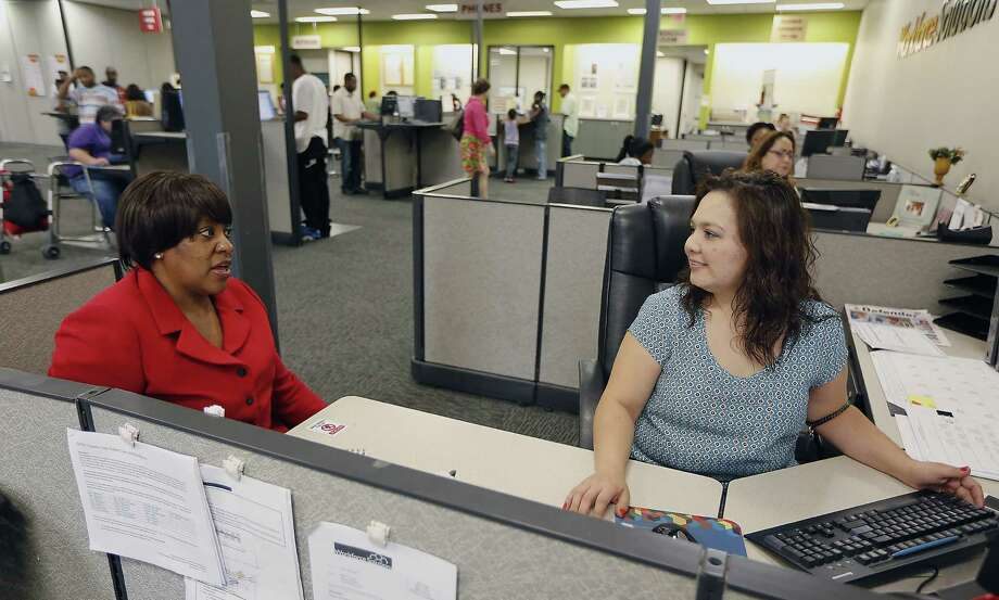 Deloris Jones (left) speaks with Workforce Solutions employment counselor Gabriela Martinez in Houston during a job search. Jones has been seeking a full-time job for a couple of months but is resigned to taking what she can find, even if it's part time. Photo: James Nielsen / Houston Chronicle / © 2014  Houston Chronicle