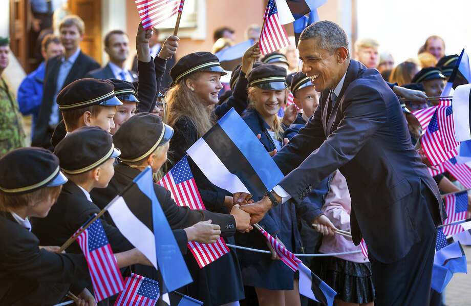 President Obama greets a group of children as he arrives at the Kadriorg Palace in Tallinn, Estonia. Photo: Doug Mills, New York Times