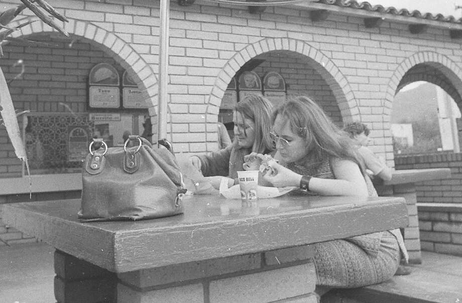 TACO BELL, Feb. 27, 1973: Two women, one with a strong Janis Joplin vibe, at the San Anselmo Taco Bell. Did people take smaller sips in 1973? A modern teenager would drain this in five seconds and demand a refill. Photo: Stephanie Maze, The Chronicle / ONLINE_YES