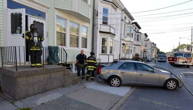 A car crashed into a home on First Street in Albany Thursday morning. The impact of the crash, which occurred shortly before 8 a.m., severed a natural gas line but authorities were able to quickly seal the link. (Skip Dickstein / Times Union)