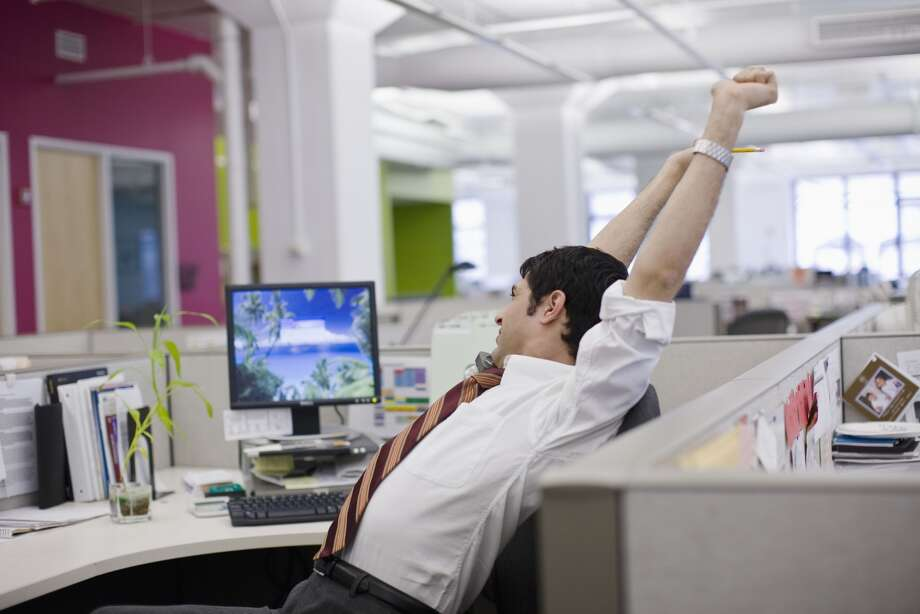 Nearly 25 percent of workers spend an hour a day or more at work engaging in non-work related activities or being distracted from work. Click through the slideshow to see what CareerBuilder and readers say are some of the most common productivity killers. Photo: Todd Warnock, Lifesize Via Getty Images