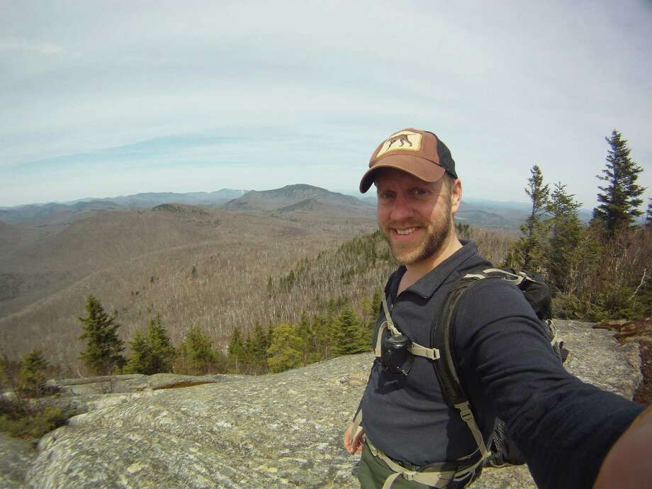 Photo by Erik Schlimmer. Author Erik Schlimmer, a Capital Region resident, is shown  atop 2,831-foot Baldhead Mountain near Thurman in the Adirondacks.