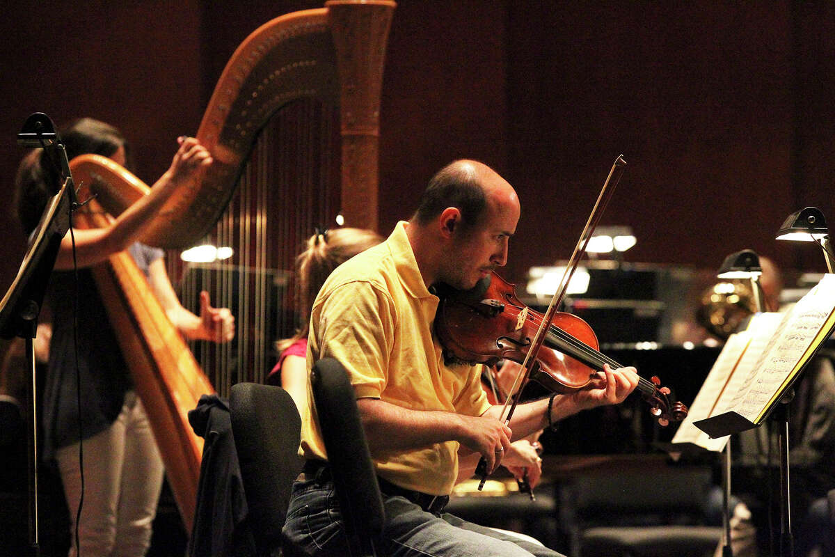 Musicians tune up as the San Antonio Symphony rehearses at the Tobin Center for the Performing Arts on September 3, 2014.