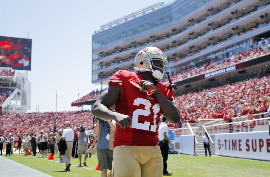 Frank Gore (21) gestures to the crowd before the start of the game as the 49ers play the Denver Broncos in the first preseason game at Levi's Stadium in Santa Clara, Calif., on Sunday, August 17, 2014. Photo: Carlos Avila Gonzalez, The Chronicle