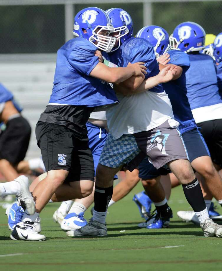 Darien lineman Mark Evanchick practices on Wednesday, Sept. 3, 2014, at Darien High School. Photo: Autumn Driscoll / Connecticut Post