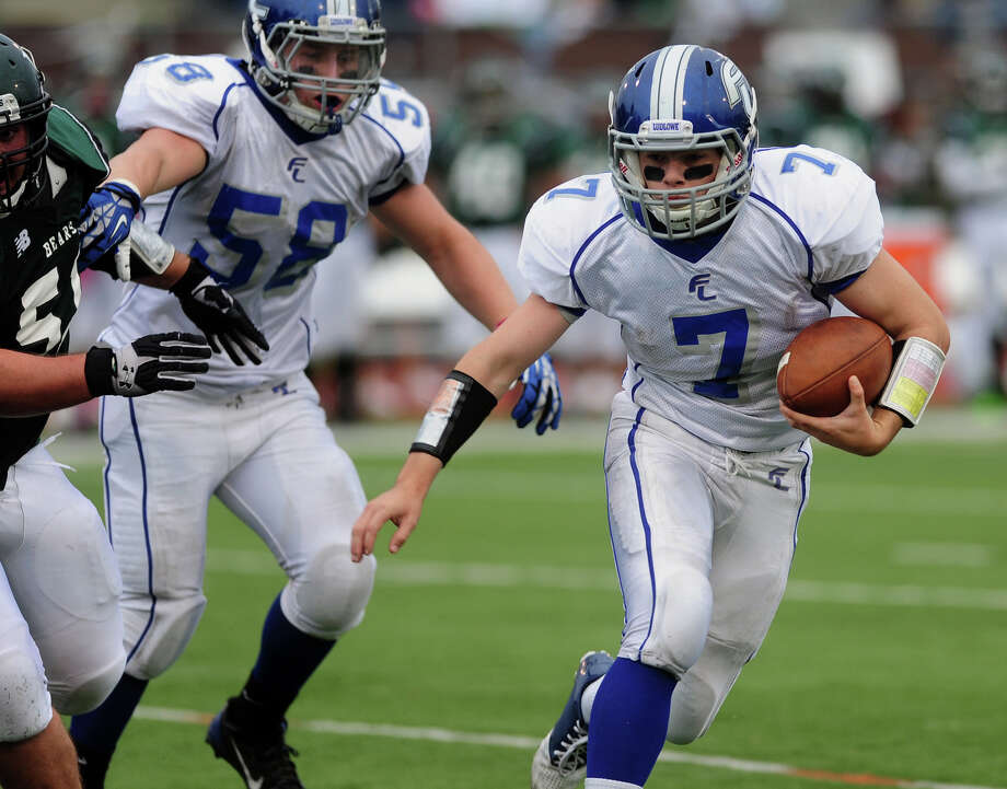 At Fairfield Ludlowe, the key question is who will replace Matt White, a three year starter at quarterback, seen here last October running the ball against Norwalk. Photo: Christian Abraham / Connecticut Post