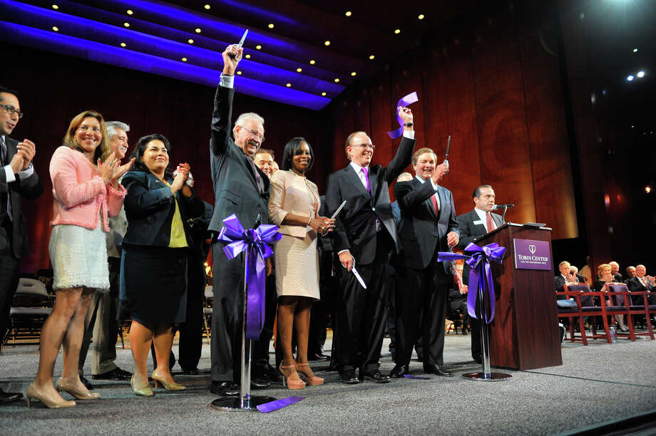 Former Mayor Phil Hardberger, Mayor Ivy Taylor, County Commissioner Judge Nelson Wolff and J. Bruce Bugg Jr., chairman of the Bexar County Performing Arts Center Fooundation wave to the crowd after cutting the ceremonial ribbon for the grand opening of the $203 million Tobin Center for the Performing Arts Thursday morning. Photo: Robin Jerstad, For The San Antonio Express-News
