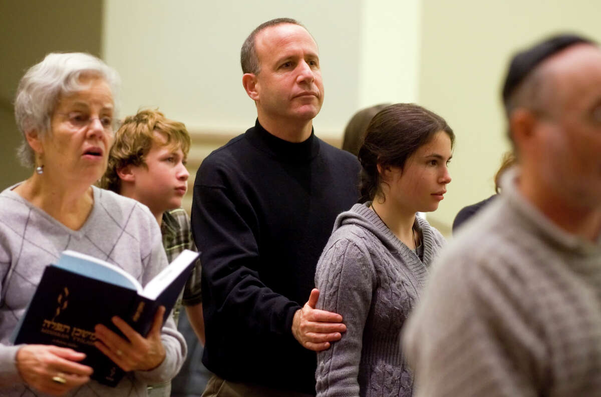 At a synagogue service in 2008, Sen. Darrell Steinberg holds his daughter Jordana, then 14, while his son Ari, then 11, stands behind him.
