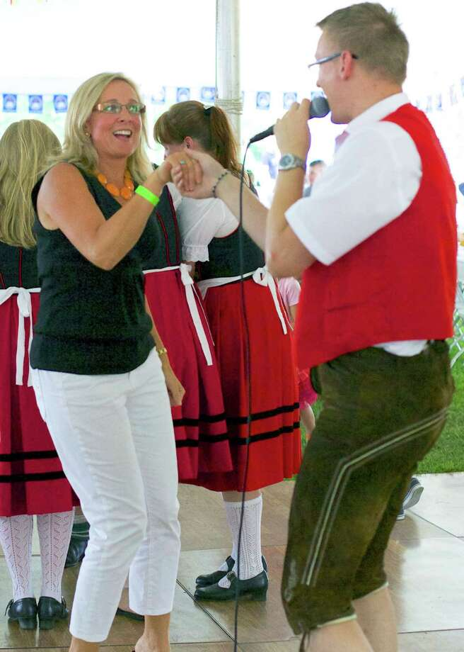 Susan Lindberg of New Milford gets in the swing of things during the Arion Singing Society's annual Oktoberfest, Aug. 30-31, 2014 in New Milford. Photo: Trish Haldin / The News-Times Freelance