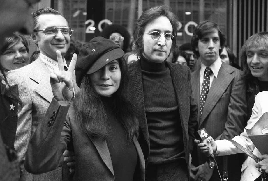 FILE - In this April 18, 1972, file photo, John Lennon and his wife, Yoko Ono, leave a U.S. Immigration hearing in New York City. The argument over President Barack Obama's legal authority to defer deportations begins 42 years ago with a bit of hashish, a dogged lawyer and, yes, John Lennon and Yoko Ono. Lennon was facing deportation from a Nixon administration eager to disrupt the ex-Beatle's planned concert tour and voter registration drive. The case hinged on Lennon's 1968 conviction for possession of cannabis resin in London. Lennon ultimately succeeded. The case's legacy is an integral part of the legal foundation Obama relied on in 2012 to set up a program that has deferred the deportation of more than 580,000 immigrants who entered the country illegally as children.   (AP Photo) Photo: Associated Press