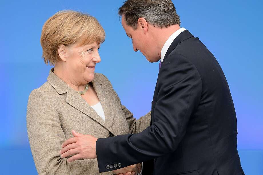 TOPSHOTS British Prime Minister David Cameron (R) greets German Chancellor Angela Merkel during the 2014 NATO Summit in Newport, Wales, on September 4, 2014. NATO leaders will aim to show unity against Russia over the conflict in Ukraine, after France suspended delivery of a warship to Moscow despite a surprise peace plan put forward by the Kremlin. AFP PHOTO / LEON NEALLEON NEAL/AFP/Getty Images Photo: Leon Neal, AFP/Getty Images