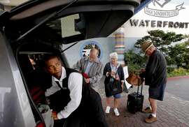 Valet, Andre Logan loads luggage into the vehicle of John Hedrick, (left center) and his sister-in-law and brother Darlene and Jim Hedrick, visiting from Wisconsin, after a two night stay at the Waterfront Hotel along the estuary in Oakland, Calif., as seen on Thursday Sept. 4, 2014. With Oakland becoming  more popular over the past few years as a tourist destination there aren't enough hotel rooms to accommodate the increase of visitors.