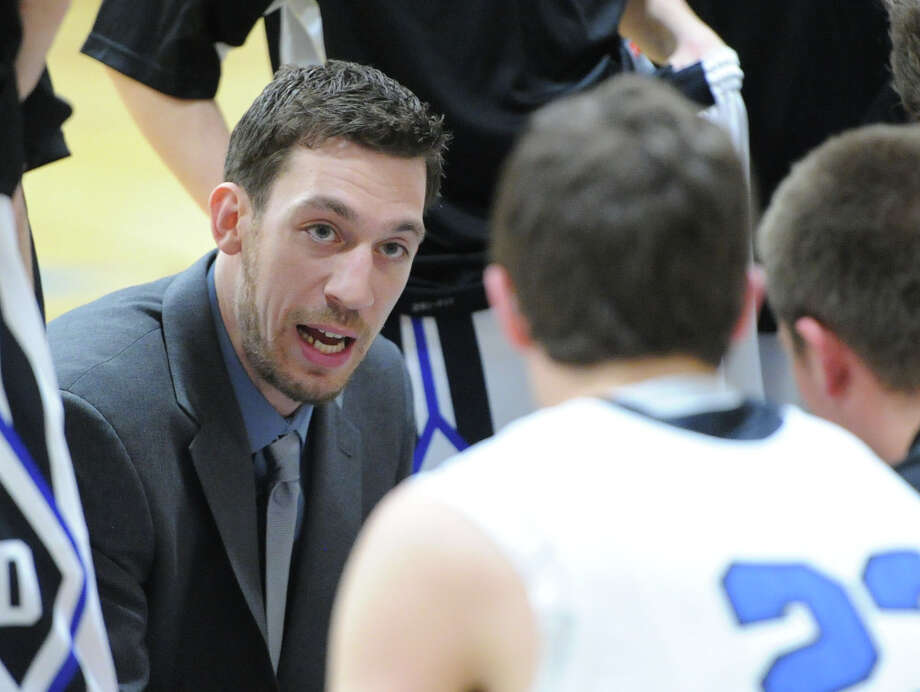 Darien High School Head Basketball Coach Kyle Marian is stepping down after four years of coaching the Blue Wave. Photo: Bob Luckey / Greenwich Time