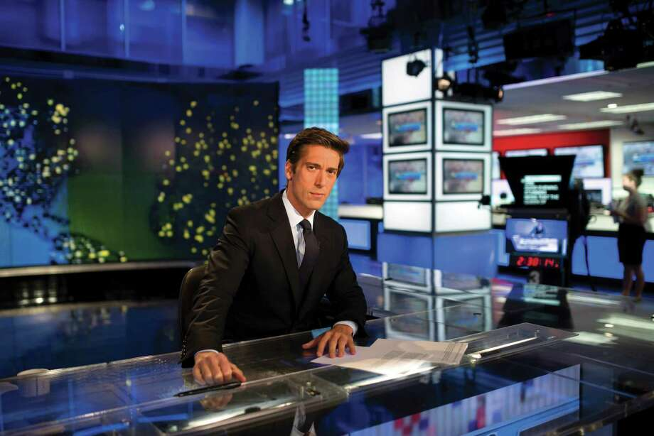 David Muir, the new anchor of ABC World News Tonight, on set in New York, Aug. 29, 2014. Muir will become the youngest national evening news anchor in 50 years, a hiring that represents the most aggressive attempt yet to find a nightly anchor for the modern era. (Karsten Moran/The New York Times) ORG XMIT: XNYT38 Photo: KARSTEN MORAN / NYTNS