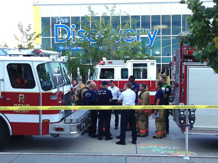 Firefighters respond to the incident at the Terry Lee Wells Discovery Museum in downtown Reno where several children suffered acid burns. Photo: Scott Sonner, Associated Press