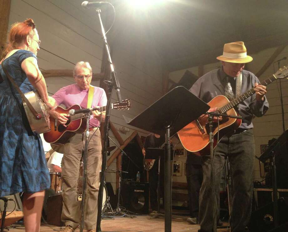 From left: Del Ray, Happy Traum and Marc Black performing Aug. 20 in Woodstock. (Photo by Amy Biancolli)