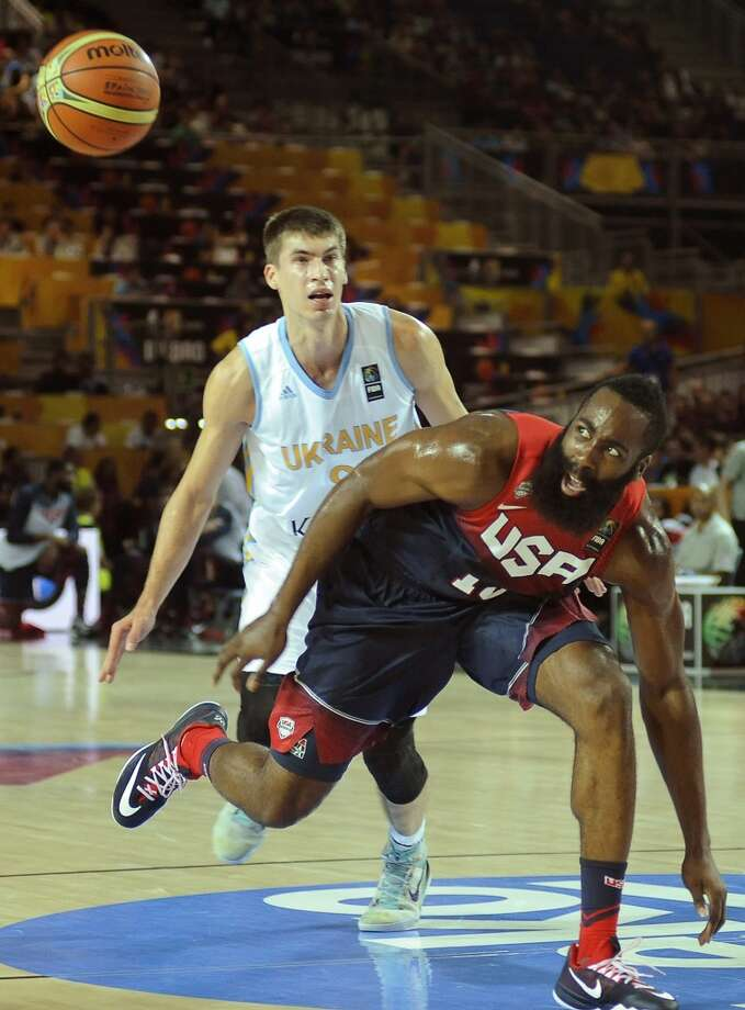 US forward James Harden (R) vies with Ukraine's guard Oleksandr Lypovyy (L) during the 2014 FIBA World basketball championships group C match Ukraine vs USA at the Bizkaia Arena in Bilbao on September 4, 2014.  AFP PHOTO/ ANDER GILLENEAANDER GILLENEA/AFP/Getty Images Photo: ANDER GILLENEA, AFP/Getty Images
