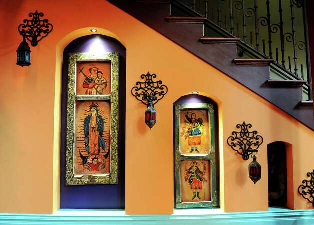 Mexican artwork adorns a stairway on Thursday, Aug. 21, 2014, at Mexican Radio in Schenectady, N.Y. (Cindy Schultz / Times Union) Photo: Cindy Schultz / 00028252A