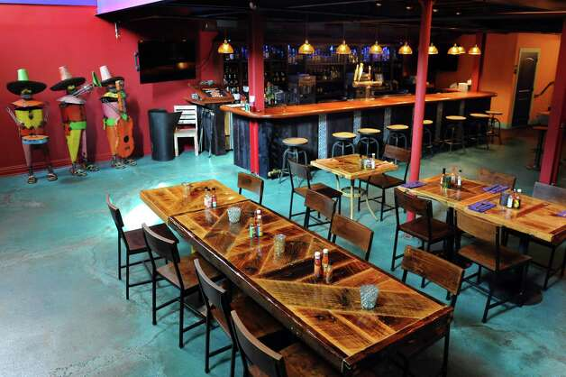One of the bar areas on Thursday, Aug. 21, 2014, at Mexican Radio in Schenectady, N.Y. (Cindy Schultz / Times Union) Photo: Cindy Schultz / 00028252A