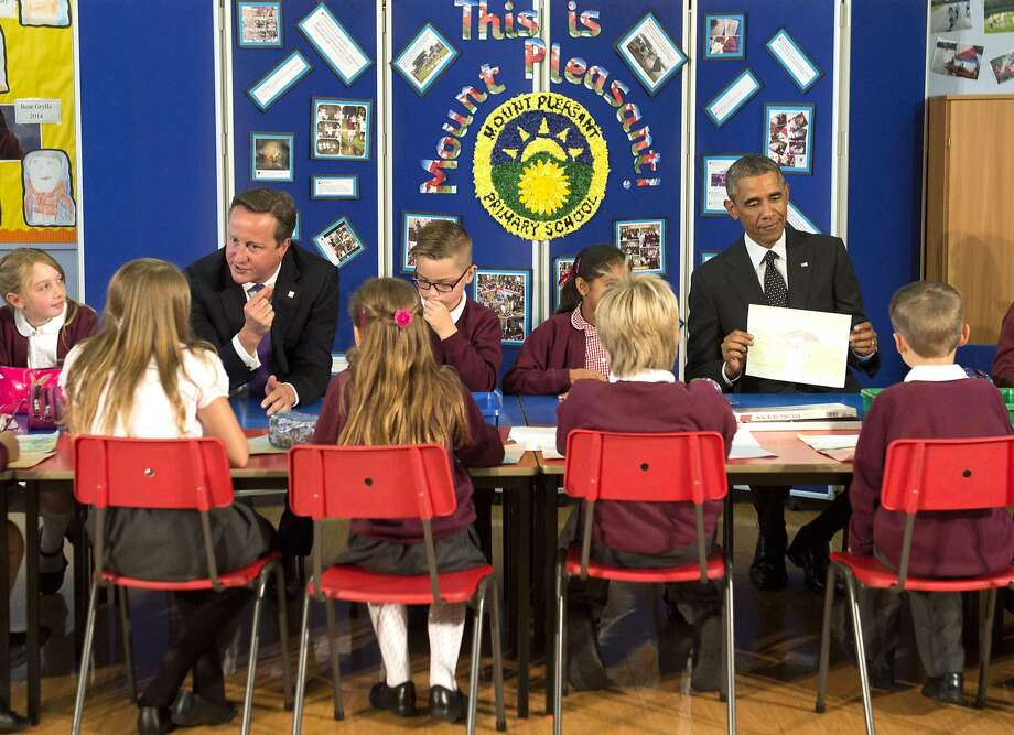 P is for Putin:British Prime Minister David Cameron and President Obama speak with school kids during their visit to Mount Pleasant Primary School in Newport, South Wales prior to attending the NATO summit. Photo: Saul Loeb, AFP/Getty Images