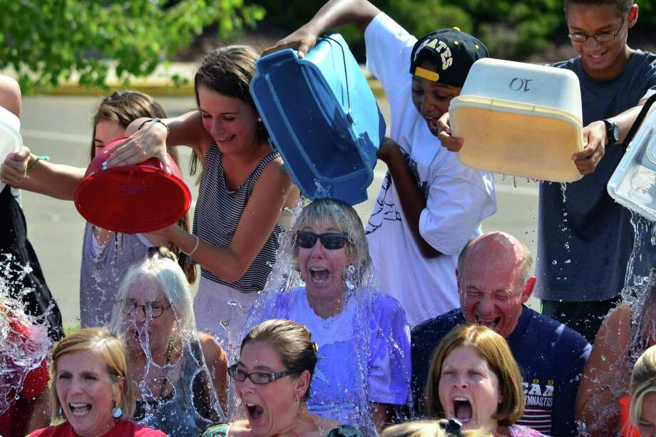 Middlesex Middle School students were given the chance to soak their teachers as part of the ALS Ice Bucket Challenge on Sept. 4. Principal Debi Boccanfuso challenged the six other schools in the district, along with the central office administrators and the Board of Education members. Photo: Megan Spicer / Darien News