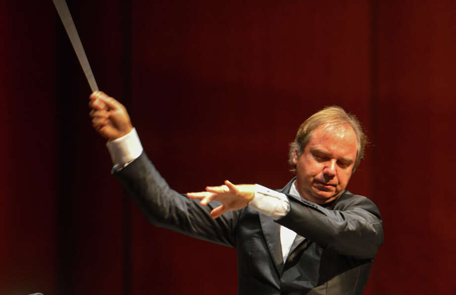 San Antonio Symphony Orchestra Musical Director Sebastian Lang-Lessing conducts the orchestra during the ribbon cutting ceremony for the Tobin Center for the Performing Arts Thursday morning. Photo: Robin Jerstad, For The Express-News / San Antonio Express-News