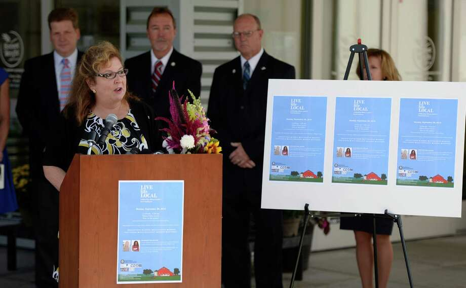 Mary Rozak, representing Albany County Executive Dan McCoy announces the Live Life Local program celebrating Albany County's local businesses at a press conference at the Honest Weight food co-op Thursday morning Sept. 4, 2014 in Albany, N.Y.  The free admission Live life Local program will be held at the Times Union Center Sept. 28th from 11am to 4 pm.  (Skip Dickstein/Times Union) Photo: SKIP DICKSTEIN / 00028478A