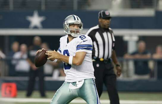 Dallas Cowboys quarterback Tony Romo (9) looks for a receiver during the first half of an NFL preseason football game against the Baltimore Ravens Saturday, Aug. 16, 2014, in Arlington, Texas. (AP Photo/Brandon Wade) Photo: Brandon Wade, Associated Press / FR168019 AP