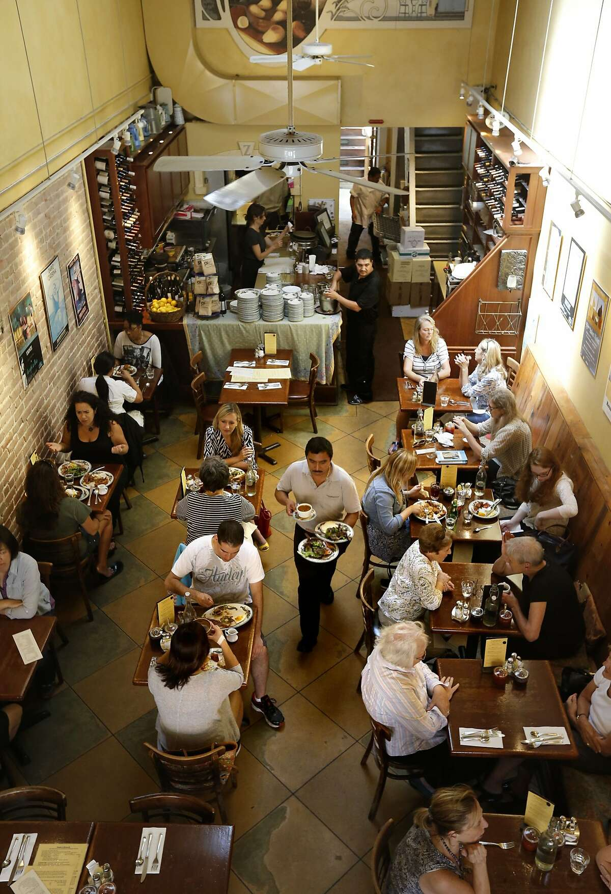 The lunchtime crowd being served at Zazie restaurant, in San Francisco, Calif., on Wednesday Aug. 27, 2014. Jen Piallat owner of Zazie offers her employees fixed schedules, full benefits and matching 401k plans and she says her business is more successful for it.