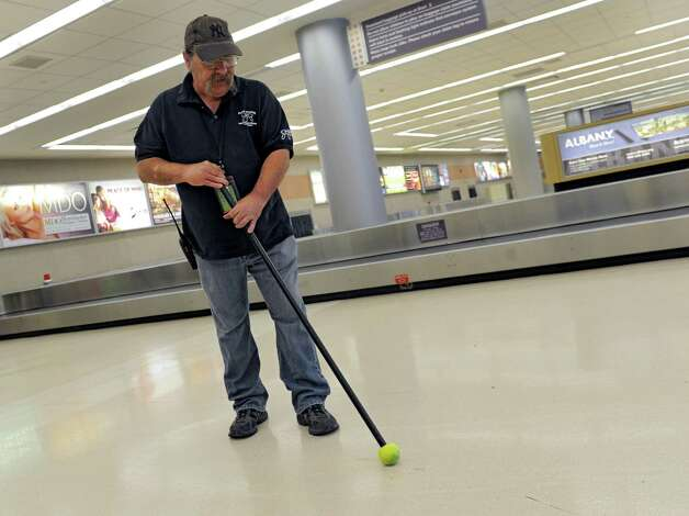 Walter Hoyt of Albany removes scuff marks in the baggage area in the Albany International Airport terminal on Wednesday, Sept. 3, 2014 in Colonie, N.Y. The airport works with the New York State Institute on Disability to find job opportunities for its clients. (Lori Van Buren / Times Union) Photo: Lori Van Buren / 00028406A