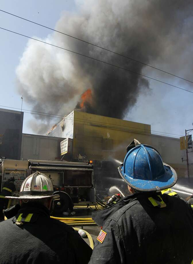 Firefighters battle a five-alarm fire on Mission Street between 22nd and 23rd streets in San Francisco, Calif. on Thursday, Sept. 4, 2014. Photo: Paul Chinn, The Chronicle