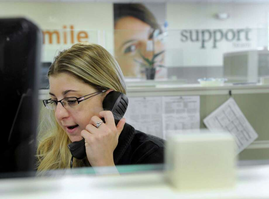 Melissa Landis, 30, of New Milford, Conn., takes a call from a customer at the customer service call center at Union Savings Bank in New Milford, Thursday, Sept. 4, 2014. Photo: Carol Kaliff / The News-Times