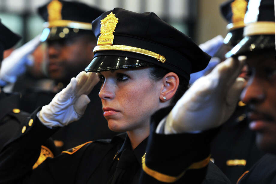 Bridgeport Police Sergeant Stacey Lyons stands at attention during the Promotion Ceremony held at Bridgeport City Hall, in Bridgeport, Conn. Sept. 4, 2014. Lyons is one of 14 officers promoted to Sergeant. Photo: Ned Gerard / Connecticut Post