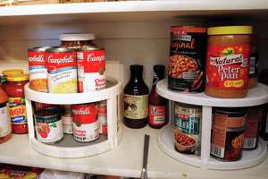 Lazy Susans keep canned goods organized in Diana Albrecht's pantry. A larger pantry is on her wish list for a dream kitchen.