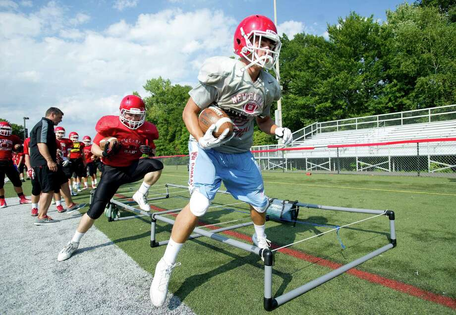 Senior captain Alex LaPolice goes through drills during a New Canaan football practice at New Canaan High School on Thursday, September 4. Photo: Lindsay Perry / Stamford Advocate