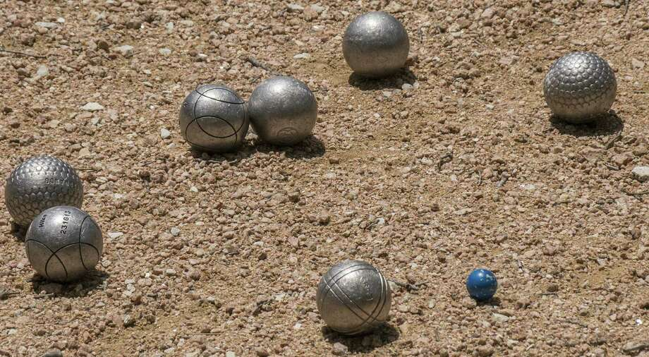 "Pétanque balls are between 70.5-80 millimeters, made of metal and weigh between 650-800 grams. The small ball is called the cochonnet — literally ""piglet"" — and serves as the target."